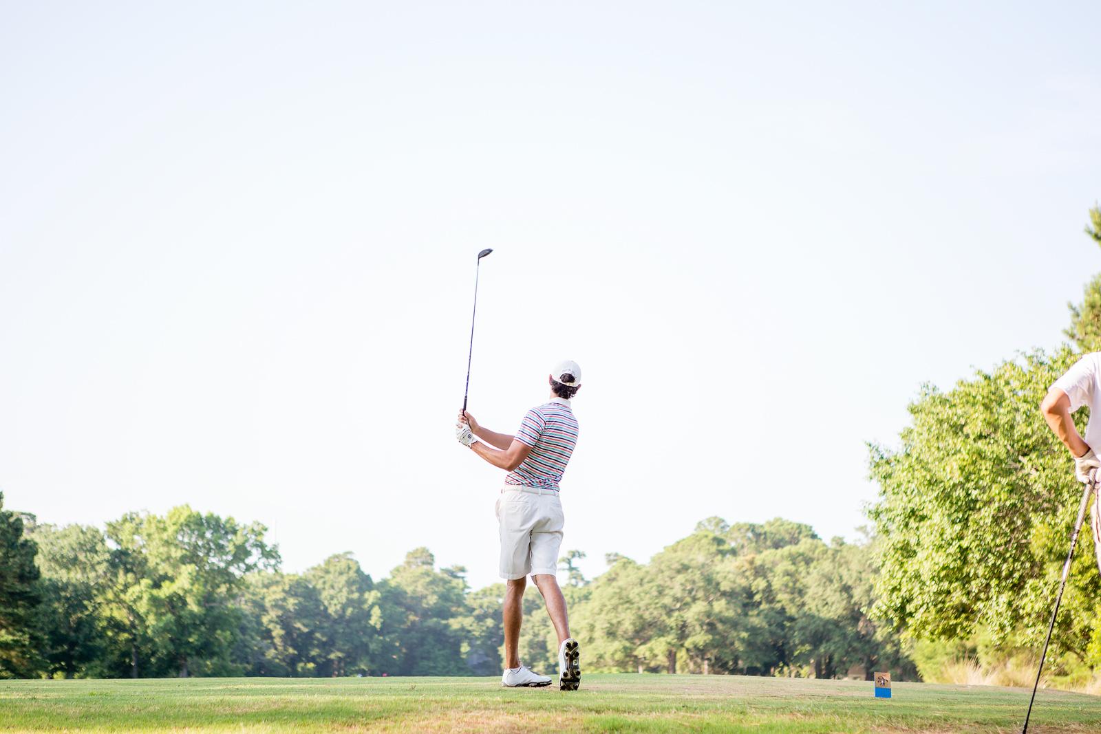 Golfer looking at horizon